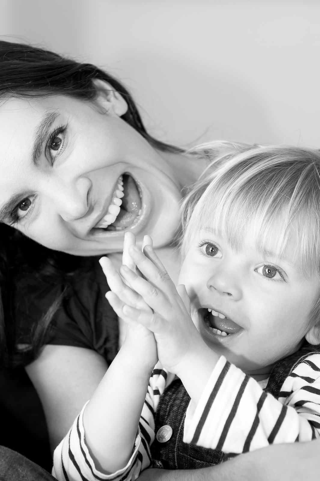 portrait photographer, portrait photography derby, Close-up family portrait, in black and white, of a woman and her young son: Liz & Theo