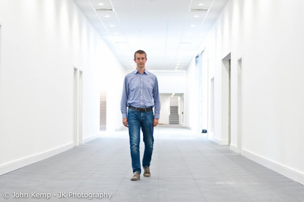 business portraits, Derby, photo of managing director walking down a corridor