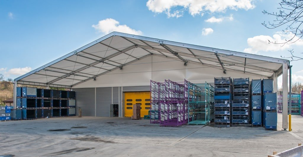A large canopy providing shelter for a loading bay