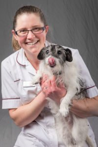 staff portrait of a woman with a dog at veterinary hospital, by freelance photographer John Kemp of JK Photography