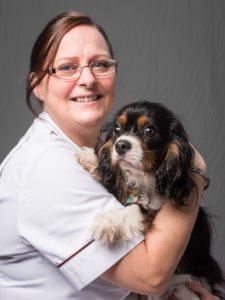 staff portrait of a woman with dog at veterinary hospital by freelance photographer John Kemp of JK Photography