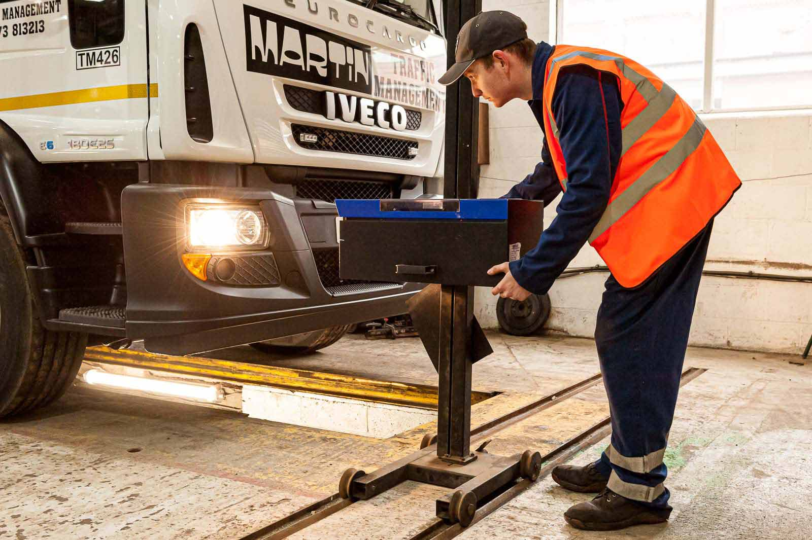 Checking headlights on an HGV at HW Martin's workshop