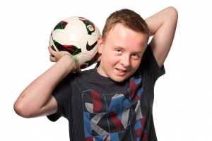 portrait photographer, portrait photography derby, Studio family portrait of a teenage boy with a football